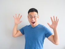 Funny surprised face of Asian man. Royalty Free Stock Photos