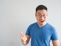 Funny surprised face of Asian man. stock images