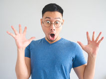 Funny surprised face of Asian man. Stock Photography