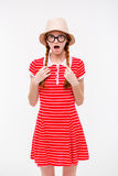 Funny surprised girl in boonie hat and round glasses Royalty Free Stock Photo