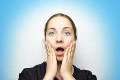 Funny surprised girl with open mouth stock photography