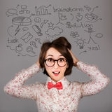 Funny Surprised Hipster Girl with Many Ideas Royalty Free Stock Photography