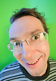 Funny surprised man in glasses portrait. On vivid color background royalty free stock photography