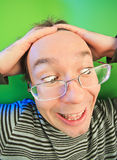 Funny surprised man in glasses portrait. On vivid color background stock photography