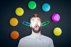 Funny surprised man with supplies Stock Photos