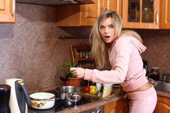 Funny surprised woman cooking dinner Royalty Free Stock Image