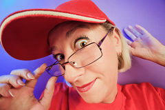 Funny surprised woman in glasses portrait. Funny surprised woman portrait on vivid color background Stock Photo