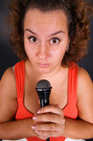 Funny surprised woman with mike Stock Image