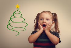 Funny surprising kid girl looking on fur tree illustration with open mouth Stock Image
