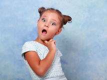 Funny surprising and very excited kid girl looking in camera on Royalty Free Stock Images