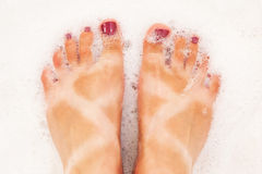 Funny tanned feet  Stock Photo