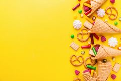 Funny tasty sweets on yellow background stock photo