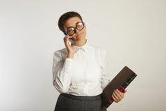 Funny teacher speaking on mobile phone stock photos