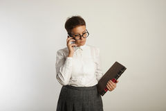 Funny teacher speaking on mobile phone royalty free stock photos