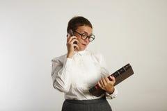 Funny teacher speaking on mobile phone stock photo