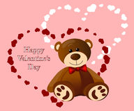 Funny teddy bear on the background of hearts stock images