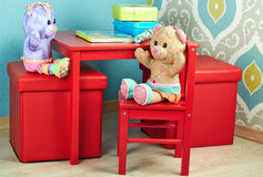 Funny Teddy Bears seat  in the nursery Royalty Free Stock Photography