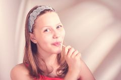 Funny teen girl eating lollypop Royalty Free Stock Photography