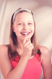 Funny teen girl eating lollypop. Beautiful funny teen girl eating lollypop Royalty Free Stock Image