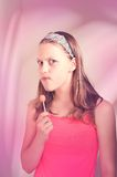 Funny teen girl eating lollypop Stock Photo