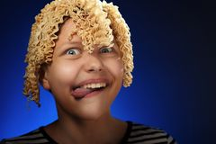 Funny teen girl with macaroni instead hair Royalty Free Stock Photos