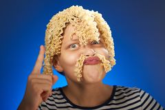 Funny teen girl with macaroni instead hair Stock Images