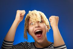 Funny teen girl with macaroni instead hair Royalty Free Stock Photo