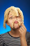 Funny teen girl with macaroni instead hair Stock Photo