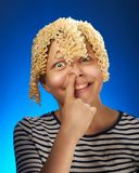 Funny teen girl with macaroni instead hair Stock Image
