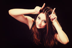 Funny teen girl making devil horns Royalty Free Stock Photos
