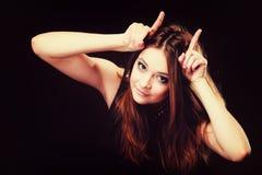 Funny teen girl making devil horns Royalty Free Stock Photos