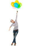 Funny teen girl posing with balloons Royalty Free Stock Images