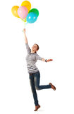 Funny teen girl posing with balloons Stock Image
