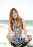 Funny teen girl sitting near the sea. Royalty Free Stock Photo
