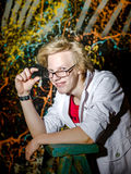 Funny teenage boy posing like a crazy professor or student Royalty Free Stock Images