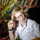Funny teenage boy posing like a crazy professor or student Stock Photography