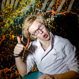Funny teenage boy posing like a crazy professor or student Stock Photos