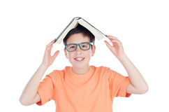 Funny teenage boy of thirteen with a book on head Royalty Free Stock Photography