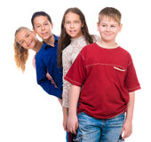 Funny teenage children standing one by one Stock Photography