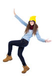 Funny teenage girl dancing in winter clothes isolated on white Royalty Free Stock Image