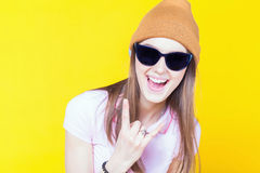 Funny teenage girl holding masquerade glasses for party Royalty Free Stock Image