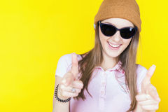 Funny teenage girl holding masquerade glasses for party Stock Photos