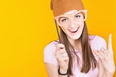 Funny teenage girl holding masquerade glasses for party Stock Image
