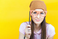 Funny teenage girl holding masquerade glasses for party Royalty Free Stock Photos
