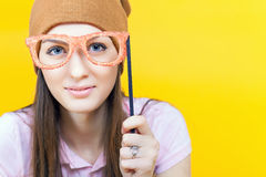 Funny teenage girl holding masquerade glasses for party Royalty Free Stock Photography