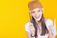 Funny teenage girl holding masquerade glasses for party Royalty Free Stock Photo