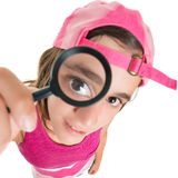 Funny teenage girl looking through a magnifying glass Stock Photo