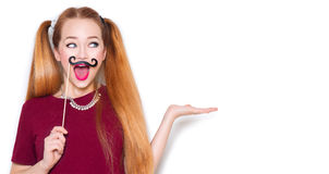 Funny teenage girl with paper mustache on stick Royalty Free Stock Images