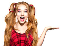 Funny teenage girl showing empty copy space royalty free stock photo