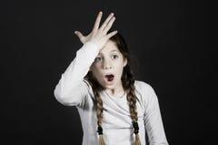 Funny teenager girl smacks on her forehead Stock Image